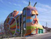 Необычные здания в виде животных на фото